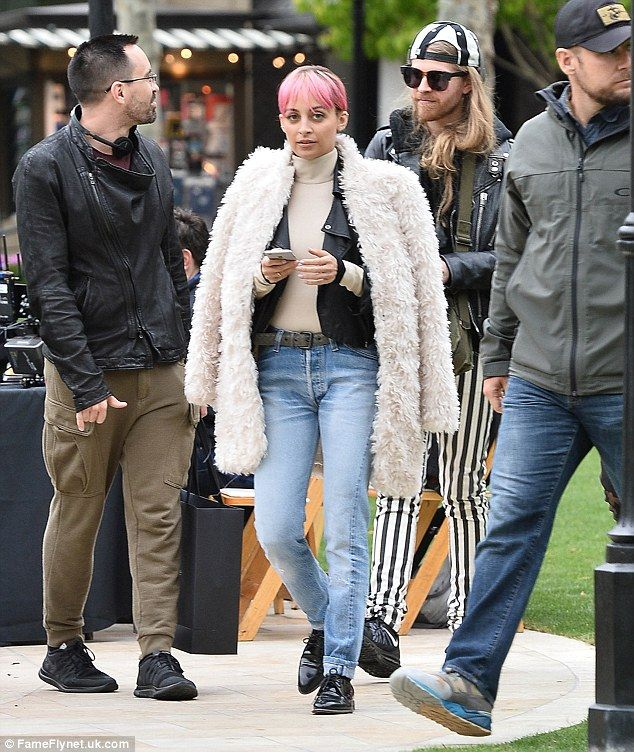 Fur goodness sake! Nicole Richie tossed on a chic white furry coat over her edgy leather jacket while filming Candidly Nicole on Friday in Glendale