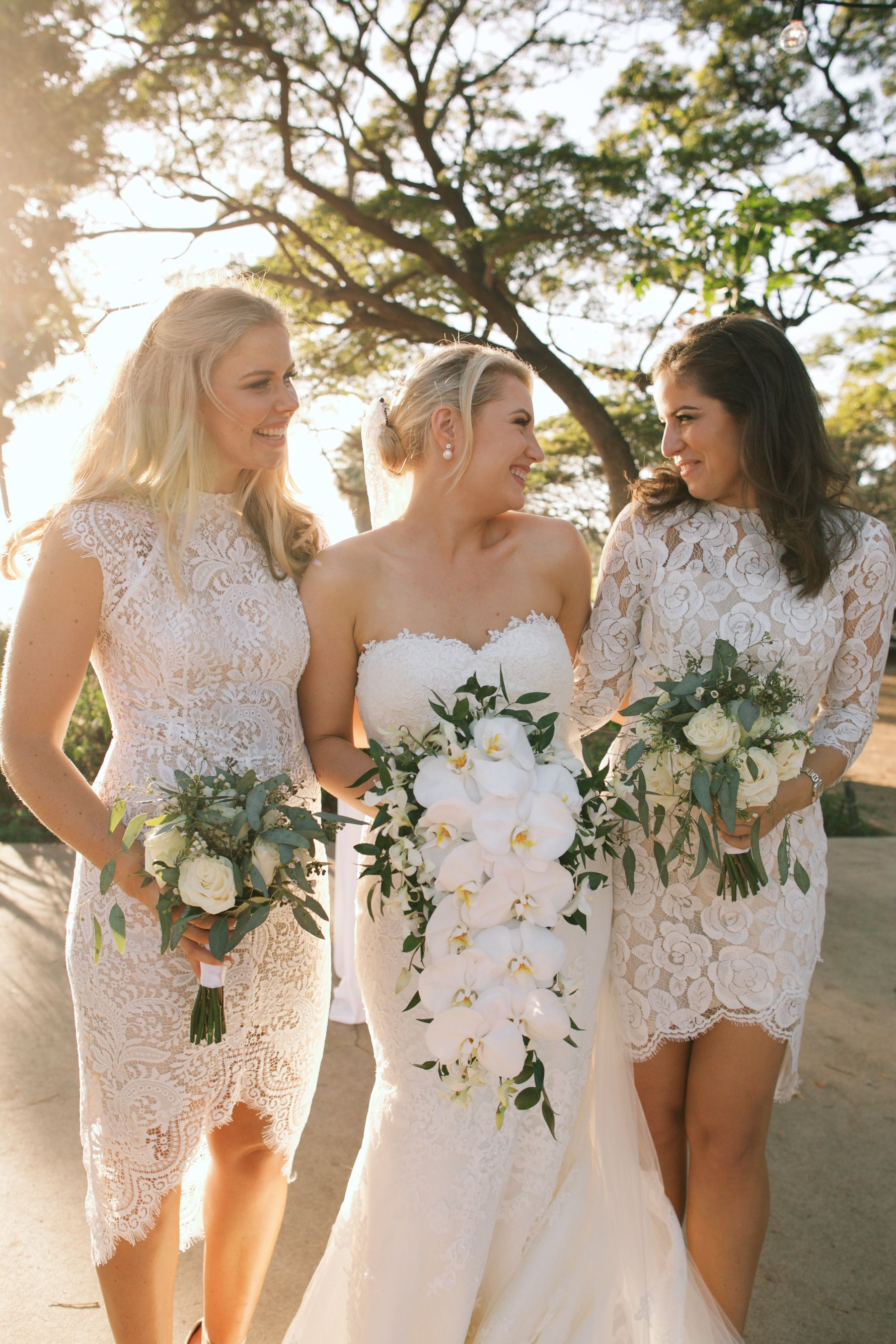 Bride With A Cascade Bouquet And Her Bridesmaids With Hand Tied