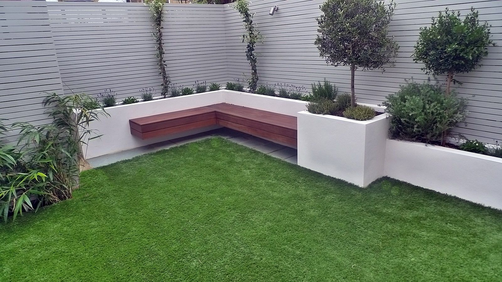 hardwood screen trellis privacy fence easi grass lawn raised beds