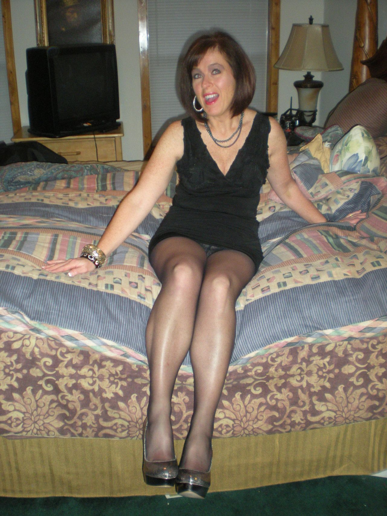 gorgeous milf in black pantyhose and short tight dress. woman in