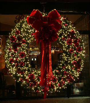 gorgeous christmas wreath white lights and red flowers wreath like this to every door - Christmas Wreaths With Lights