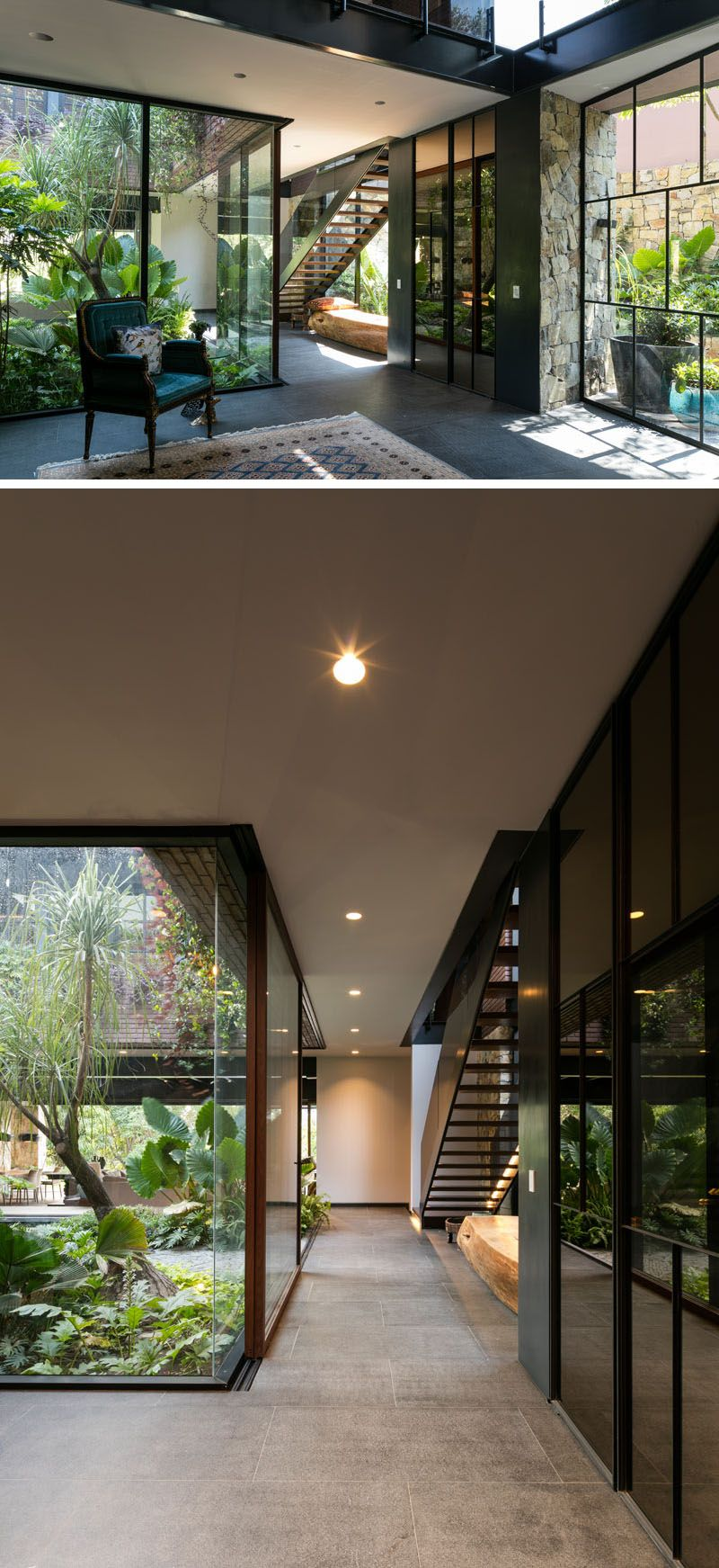 This modern house has a glass wall that shows off the internal courtyard from hallway