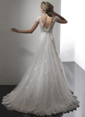 vintage short sleeved lace wedding dress..Laurie I know you don't want long but this is so elegant!!!
