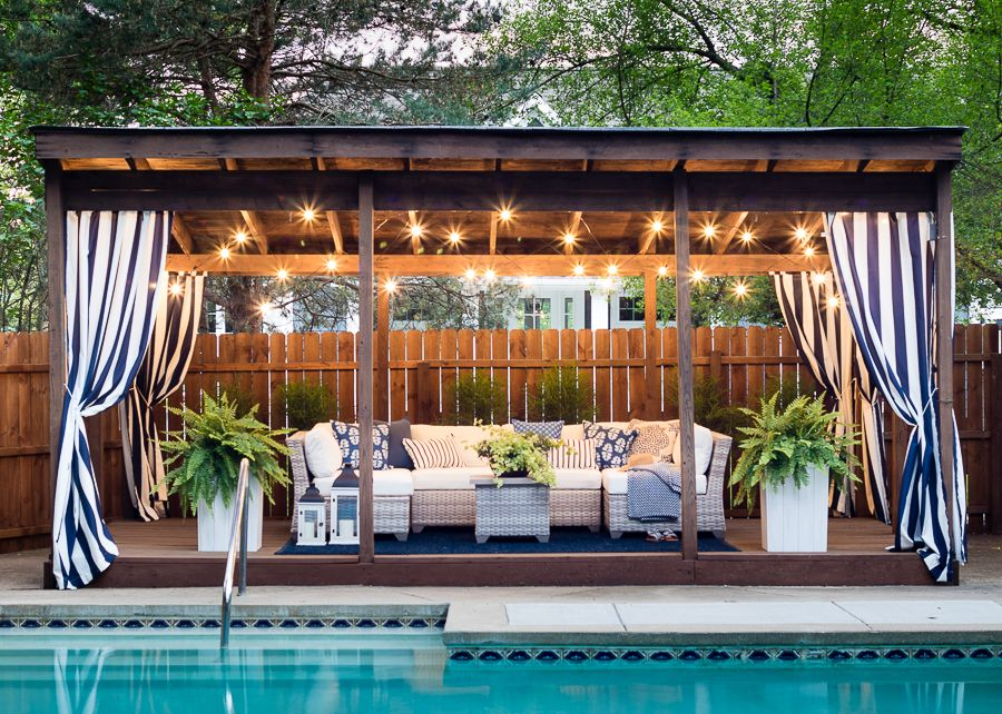 Pool Cabana Makeover is part of Outdoor rooms, Pool gazebo, Backyard pool, Backyard cabana, Simple pool, Pool cabana - pool cabana makeover  white and grey outdoor sectional, blue and white throw pillows and striped outdoor drapes make for a coastal pool vibe