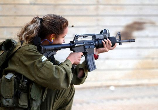 IDF Soldier firing her CAR 15 - note the reliable A1 upper receiver