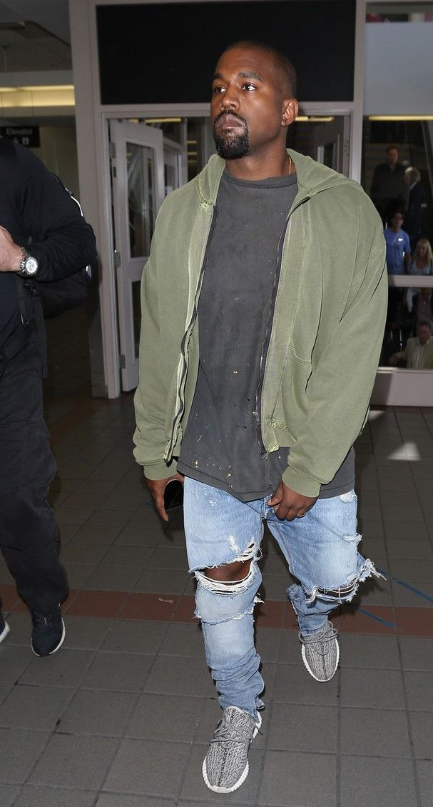 Kanye West Spotted At Lax Wearing Yeezus Hoodie Maison Margiela Pants Yeezy Boots Airport Style History Kanye West Style Yeezus Hoodie Kanye Fashion