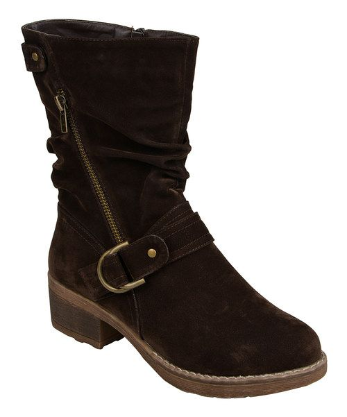 Though they sport a lower profile, this slightly slouched pair of boots still maintains it style. A buckle across the ankle and stylishly placed zipper closures enhance the look of these shoes.2'' heel9'' shaft12'' circumferenceZipper closureMan-madeImported