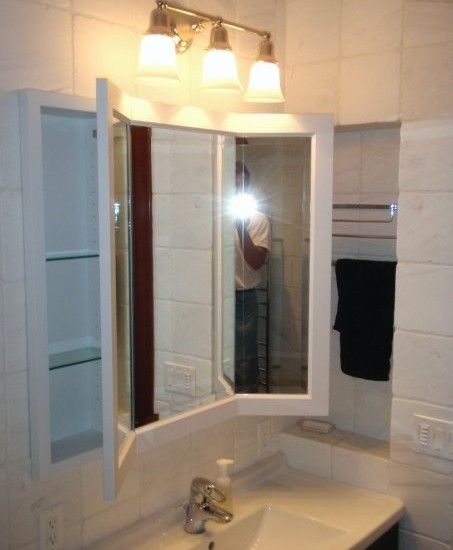 Traditional Bathroom With Three Way Mirror And Two Medicine