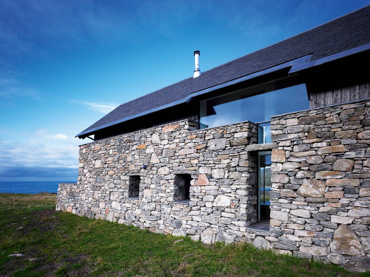 Lovely stone facade with slate roof ideas facades for Modern stone houses architecture