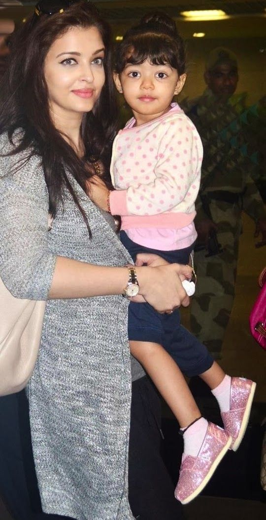 Aaradhya Bachchan was spotted at the airport in her mum Aishwarya's arms on their return from Dubai this weekend. The tiny tot, who recently turned 2, looks super-cute as she resembles dad Abhishek, but of course she has her mom's beautiful complexion.