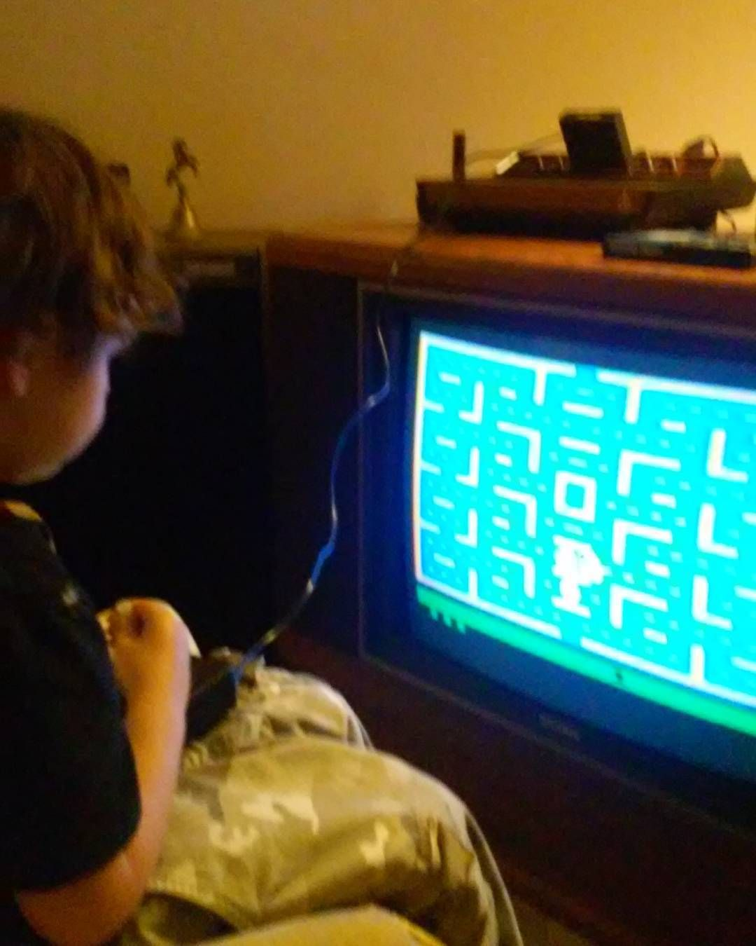 You'd like this one by orangeporridge39 #atari2600 #microhobbit (o) http://ift.tt/263rWFh my oldest learning how to play Pac Man on a real Atari 2600! Yes your eyes are not playing a trick on you that's a floor tube tv set. Daddy loves his vintage   #videogame #atari  #vintage #kids #photooftheday #instagram #instagrammers #instamood #instadaily #igers #igdaily #parentingwin #geek