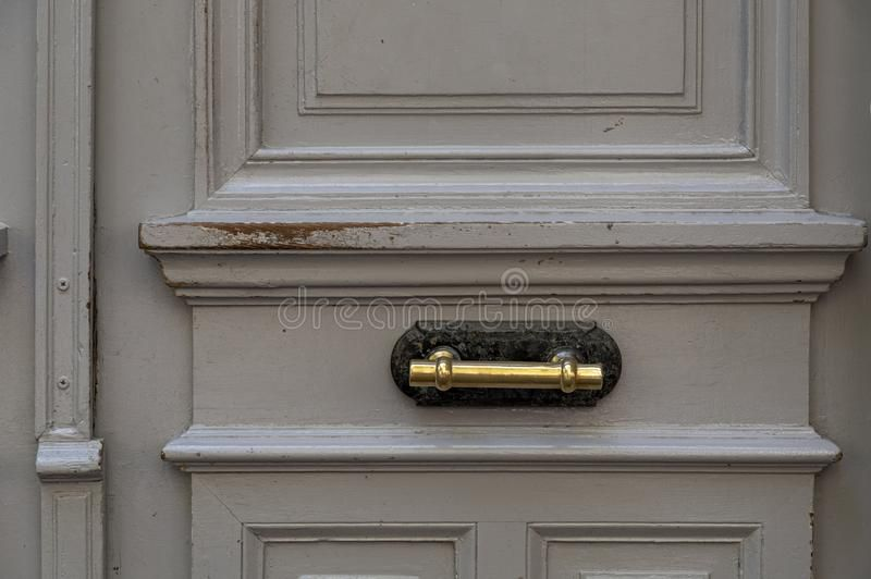 Photo of Grey Painted Wooden Door With Scratched Surface Closeup. Framed Wood Panel With Shiny Brass Vintage Handle. Architectural Details Stock Photo – Image of dirty, europe: 161948456
