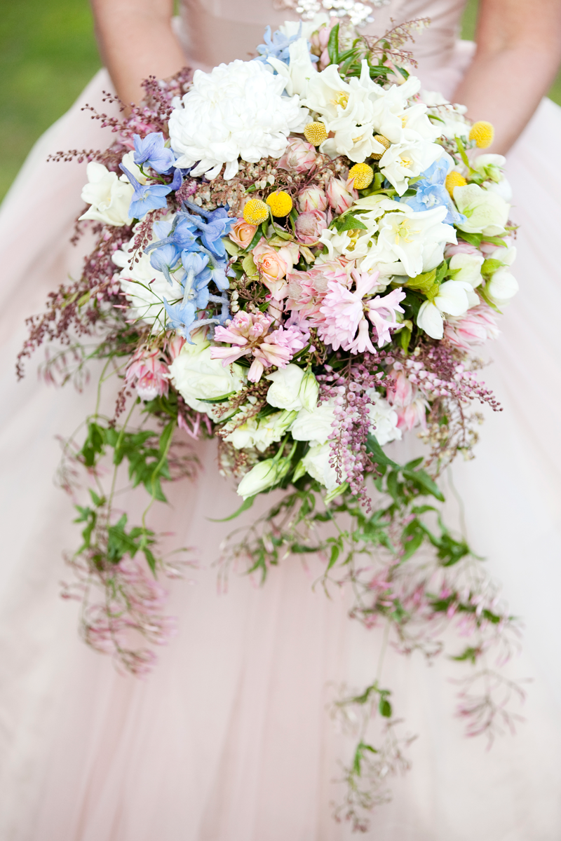 Cascading natural stem trailing bouquet featuring double tulips native bouquets by mondo floral designs maleny dhlflorist Choice Image