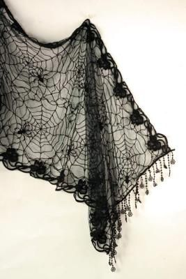 """Cobweb Shawl    Patiently created in her forest studio, Miss Spider's lacework has inspired a diaphanous drape of natural beauty. Softest cotton blend. White Witch or Black Widdow. 20 x 63""""."""