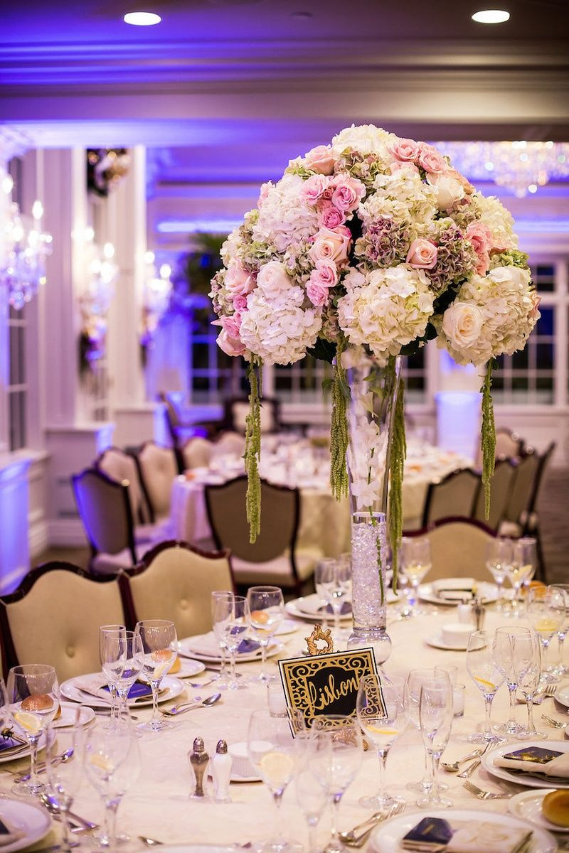 Wedding reception centerpiece of white, green, purple ...