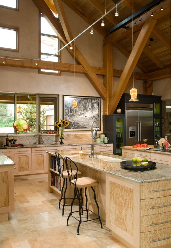 Low-voltage lighting spans the vaulted kitchen, where Matt and Clare's modern-mountain aesthetic shows in their choice of cabinets, countertops, furnishings and artwork
