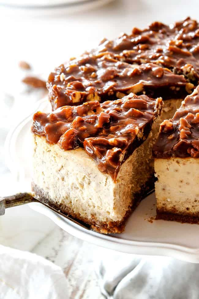 Pecan Pie Cheesecake with a luscious layer of creamy spiced cheesecake topped with caramel pecan topping is guaranteed to be a new holiday favorite! #pecanpiecheesecakerecipe
