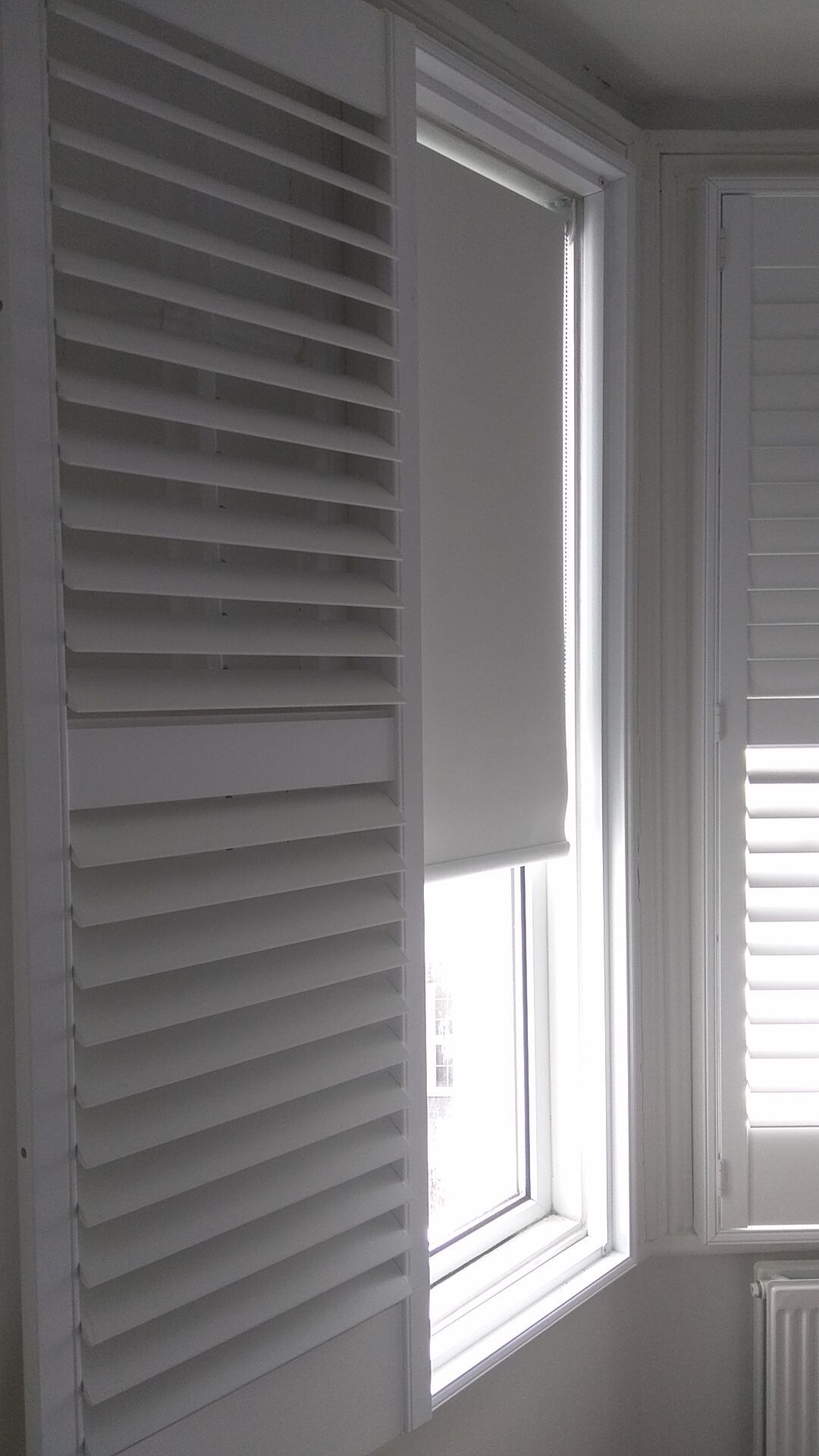 Kitchen window roman blinds  blackout roller blinds in polar colour which we fitted to bedroom