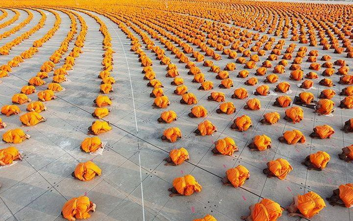 You'd never believe it, but these are lines of praying monks.