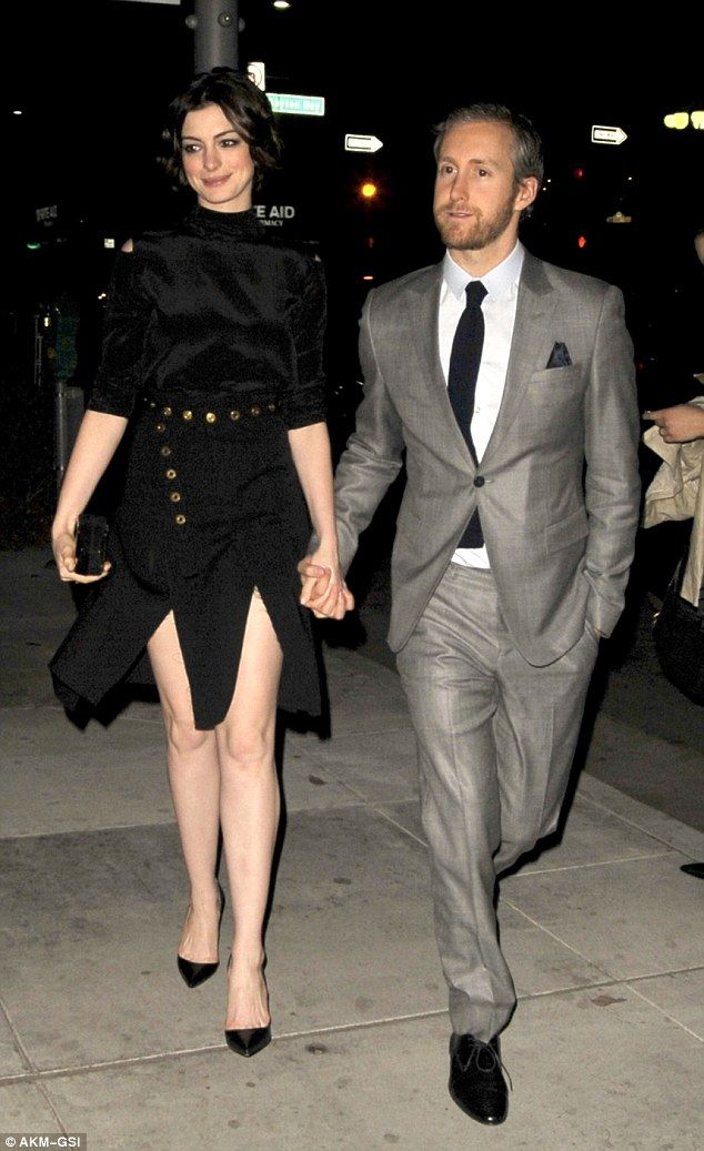 Joint effort: Anne Hathaway and her husband Adam Shulman arrived at a party for their new film Song One