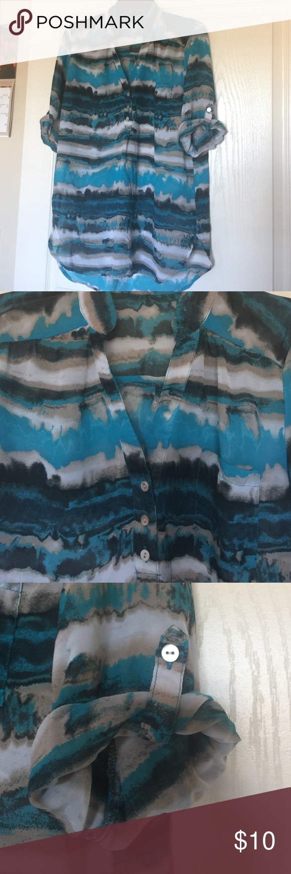Nice sheer button up top Cute sheer button up top. Nice to wear with jeans or dress pants. Tops Button Down Shirts