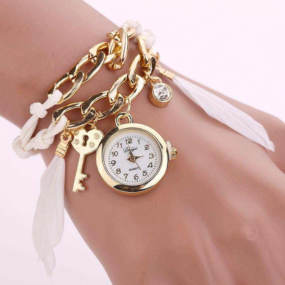 Click to Buy << Duoya Brand Quartz Fashion Feather Pendant Gold ...