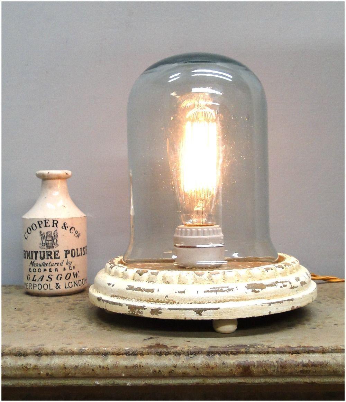 Thomas edison light bulb mounted inside globe on wood base end table thomas edison light bulb mounted inside globe on wood base end table fixture arubaitofo Image collections