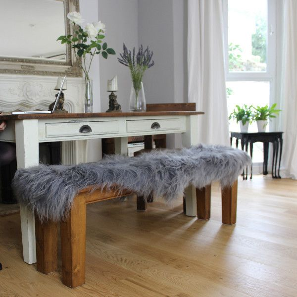 Grey Sheepskin Rugs on Wooden Bench - get the look at Modish Living!