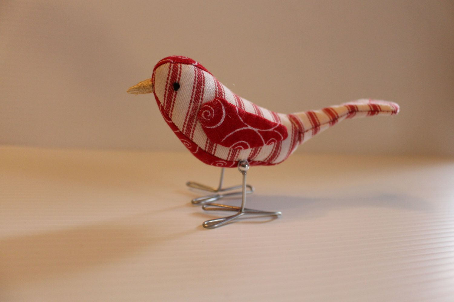 Christmas bird figurine made from red swirls and red striped pillow ticking fabrics, Christmas ornament, or bird decor by stitchopoly on Etsy