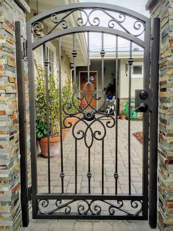 20 Iron Security Door Ideas With Beautiful Design You Can Use For Your Home Wrought Iron Gate Designs Iron Gate Design Wrought Iron Garden Gates