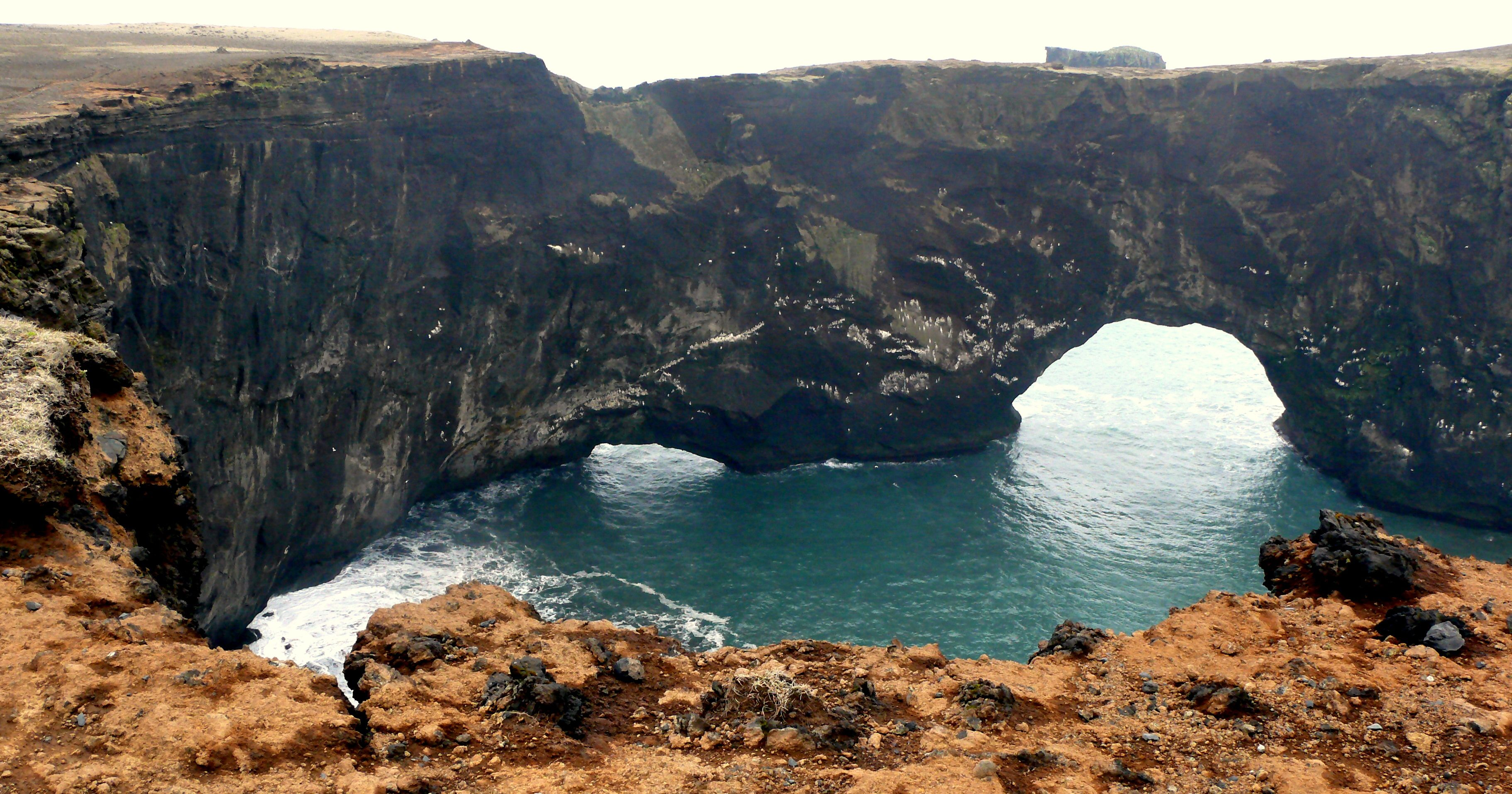 Natural arch or bridge formed by erosional processes  (Photo by Judith B. Trimarchi starranchnm.com)  Iceland