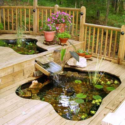 backyard pond built right into two level deck system neat idea - Garden Ideas On Two Levels