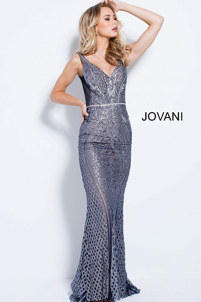 52a6c75ec4c Floor length form fitting navy silver embellished prom dress with mesh  sides and small train features sleeveless bodice with v neck and open back.