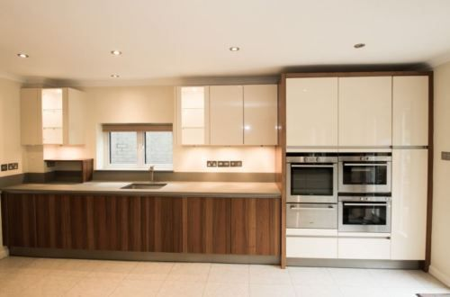 Large Modern Used Kitchen In High Gloss Cream Walnut Coloured Units