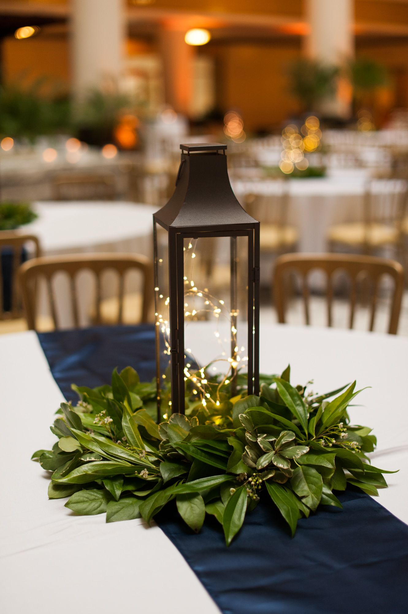 lantern centerpiece with simple greenery wedding goodies. Black Bedroom Furniture Sets. Home Design Ideas