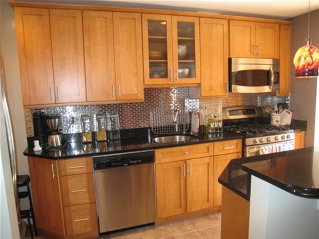 Kitchens with light wood cabinets and black countertops for Dark oak kitchen cabinets