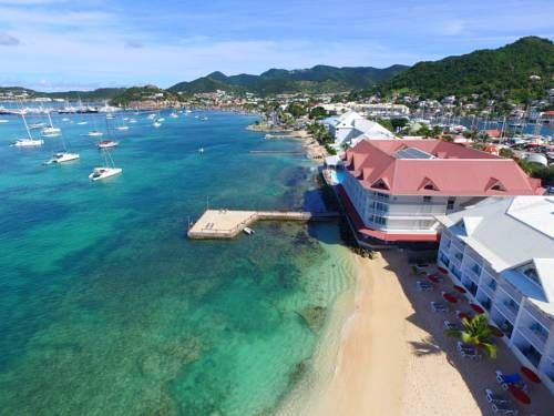 Le Beach Hotel Saint Martin F.W.I Overlooking the Canal d?Anguilla, this hotel has a private beach area on St Martin?s Marigot Bay. It offers an outdoor pool, fitness centre and air-conditioned rooms with a private balcony.
