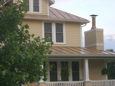 Best Yellow House Metal Roof Small House Exteriors Tin Roof House House Exterior 400 x 300