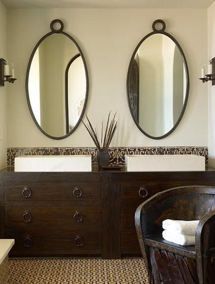 Picture Collection Website Suzie Kara Mann Design Green u brown Mediterranean bathroom design with soft green walls Love the cabinets u mirrors
