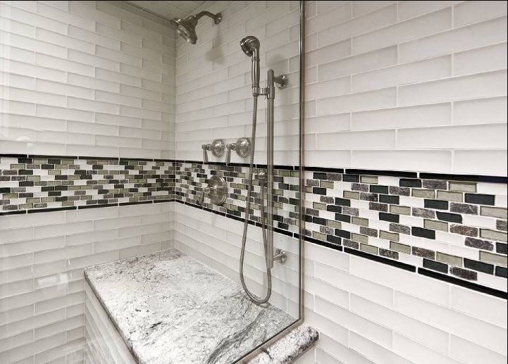 white porcelain tiles on sides of bathshower with horizontal accent glass tile accent stripe in tub vertical stripe in the in the master bath