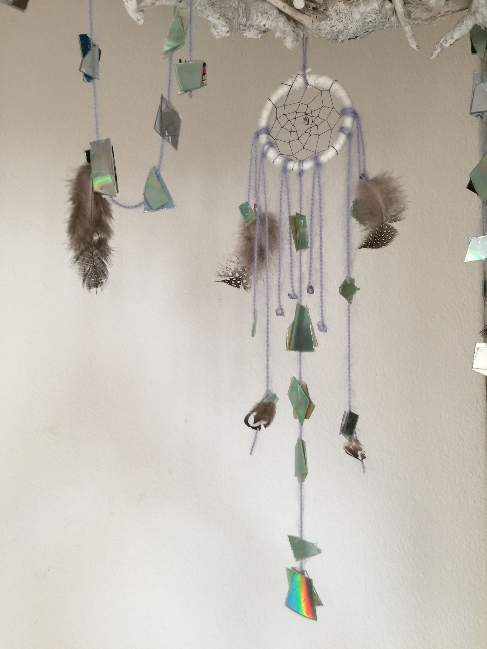 DIY Dream Catcher with CD peaces and feathers. Made by Allison Kim