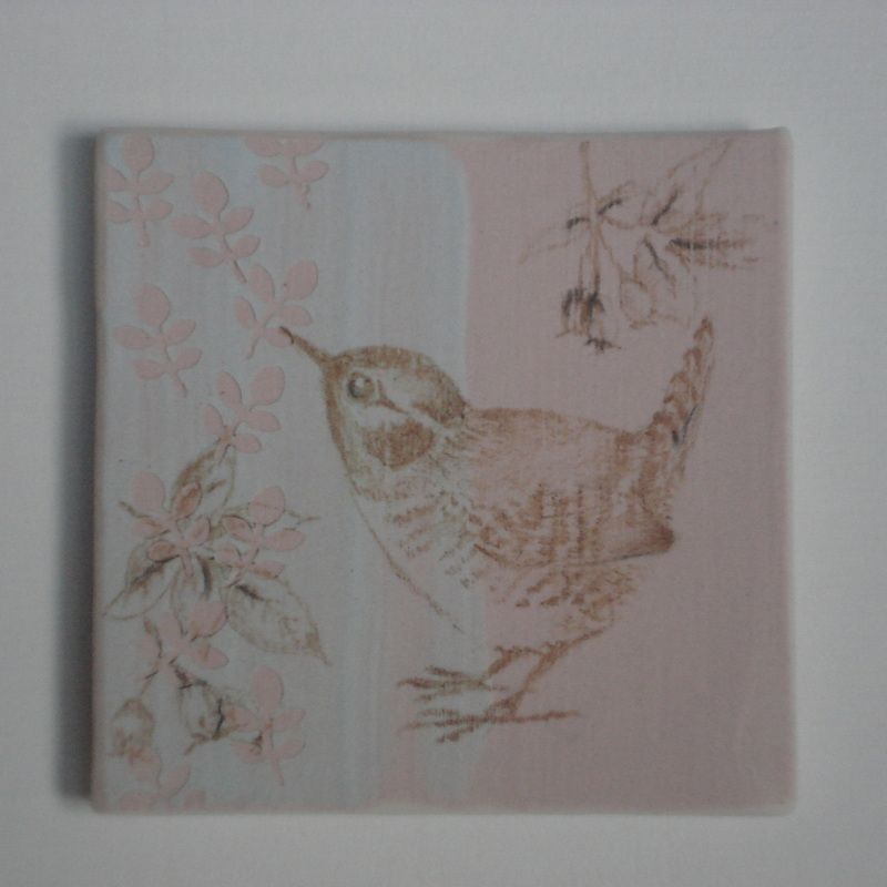 Hand painted Wren on porcelain tile with coloured slip, mounted in 8inch square frame. £35.00
