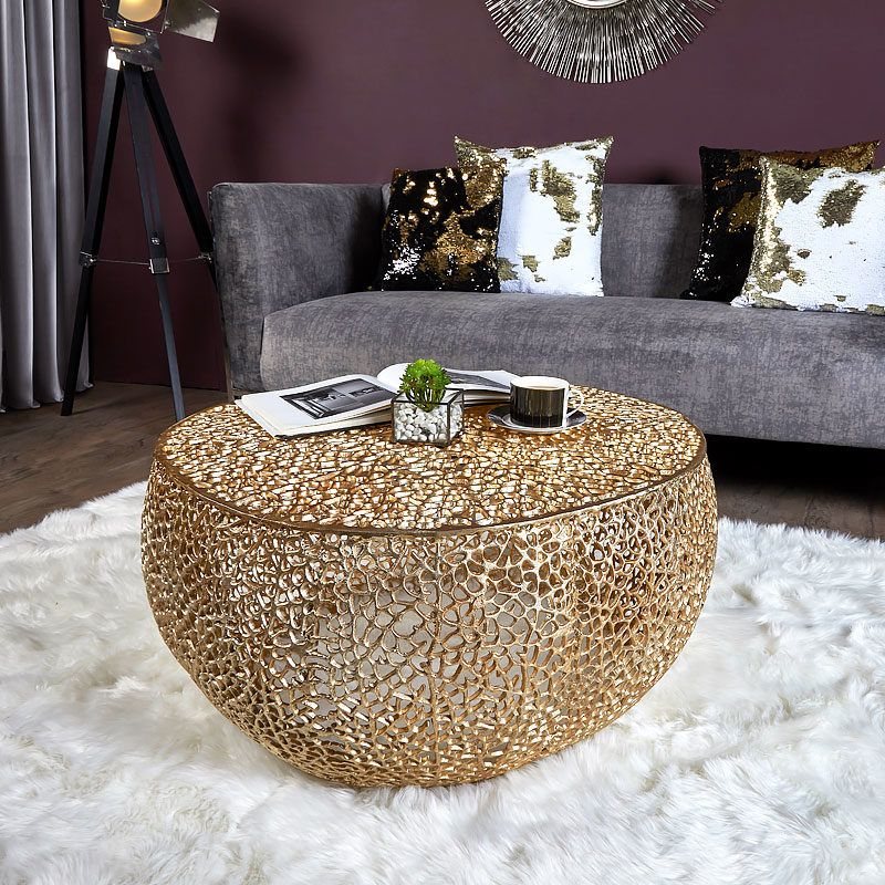 Coralie gold medium round metal coffee table with a coral