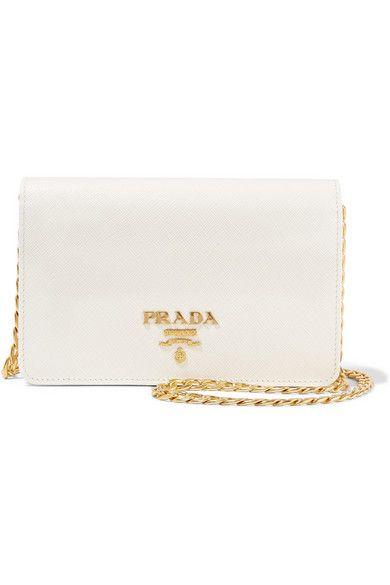 a8e99913e666e PRADA Wallet On A Chain Textured-Leather Shoulder Bag.  prada  bags   shoulder bags  leather
