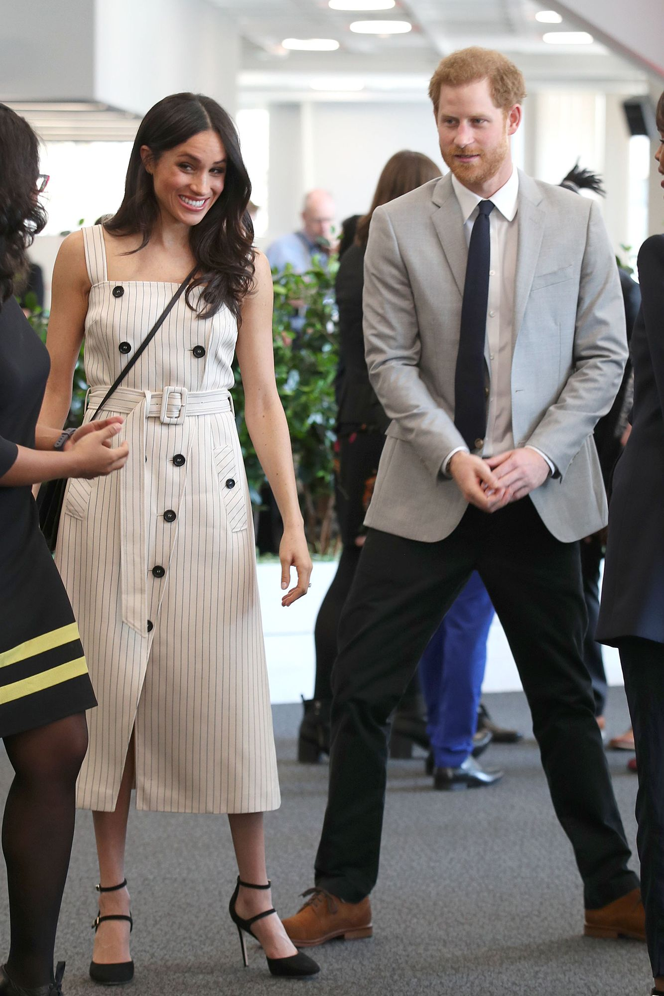 e8b9befc54b3 Bride-to-Be Meghan Markle Wears a Chic White Dress – One Month ...