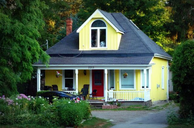 houses with red doors | sightlines: two yellow houses with red