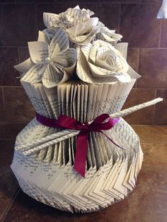 "This vase fold is on my ""Book Art Tutorial"" board, but I decided to make it a little different and show the corner folds. All the tutorials for the flowers are on my ""Book Art Tutorial"" board, too."