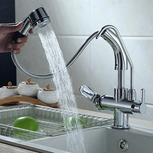 Pull-down sprayer with water filtering kitchen mixer tap allows for ...