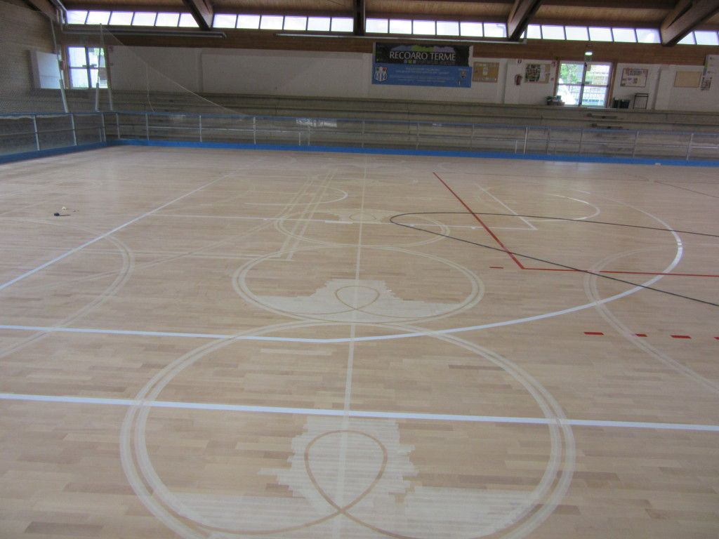 On The Sports Flooring Appear The First Traces Of Wheels For Skating - Skate court flooring