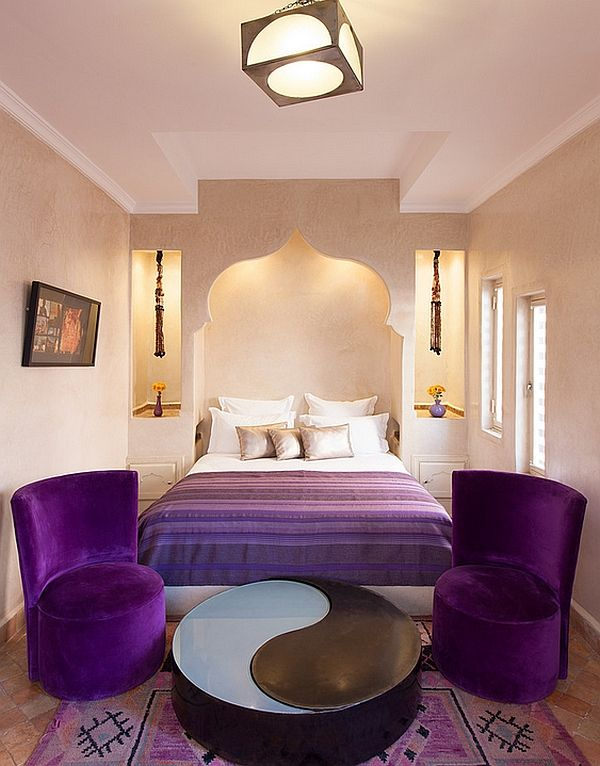 Modern Dreamy Moroccan Bedrooms That Blend Rich Color With Cream Wall Wall  Art Purple Bed Cover White BedWhite Pillow Purple Chairs Round Table  Hanging. Plush purple accents breathe life into the stylish Moroccan